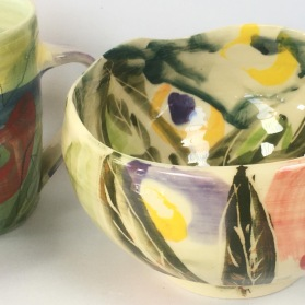 Bowl and coffee mug. Decorated earthenware