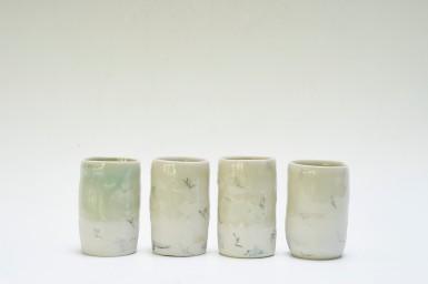 Porcelain unomis. Celadon with wax resist and pencil markings. Each 8cmh.