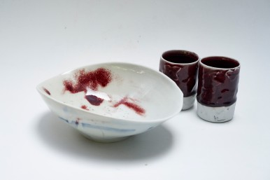Porcelain bowl and unomis. Traditional oxblood glaze